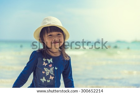 little girls on the beach - stock photo