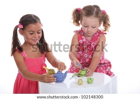 Little girls playing, studio shot - stock photo