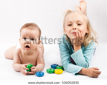 Little girls playing with colorful blocks - stock photo