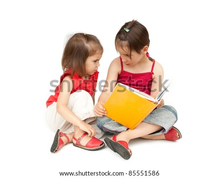little girls reading a book - stock photo