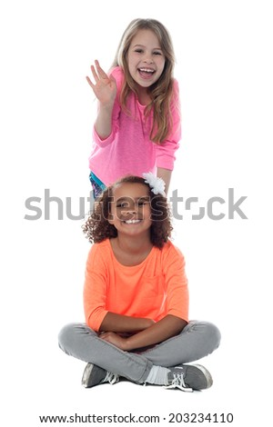 Little girls sitting with her legs crossed - stock photo