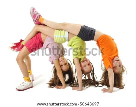 Little girls standing on her arms - stock photo