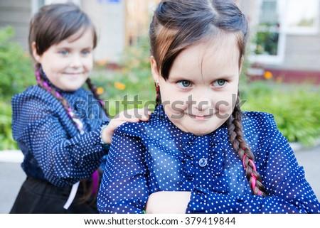 Little Girls twins near school conflict - stock photo