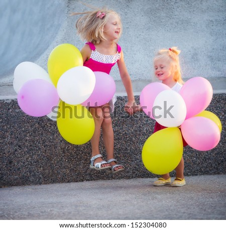 Little girls with color balloons - stock photo