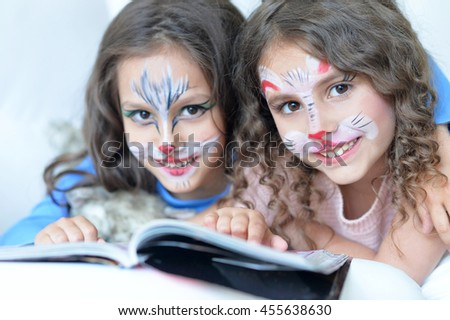 little girls with face painted - stock photo