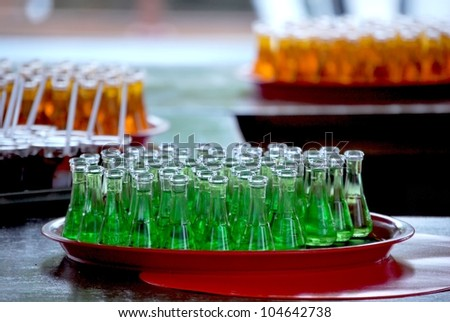 little glass bottles with liqueur on a bar table - stock photo