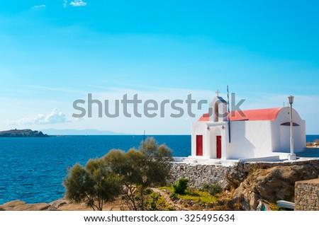 little greek orthodox chapel on a beach on mykonos, greece - stock photo