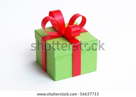 little green boxes with red bownknot - stock photo