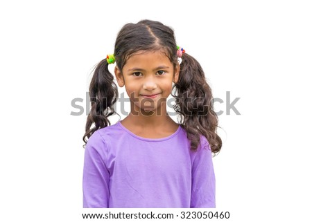 Little gypsy child girl with ponytail smiling isolated on white background - stock photo