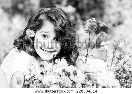 Little haired girl in autumn - Black and white photo - stock photo