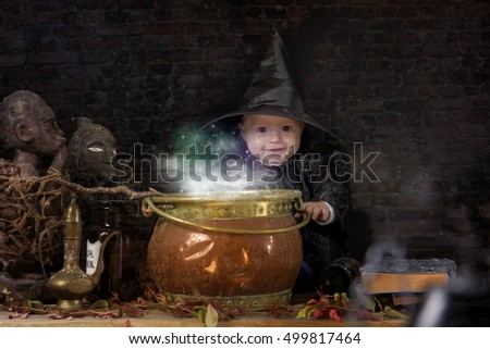 little halloween witch baby with cauldron