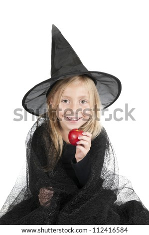 little halloween witch with apple - stock photo