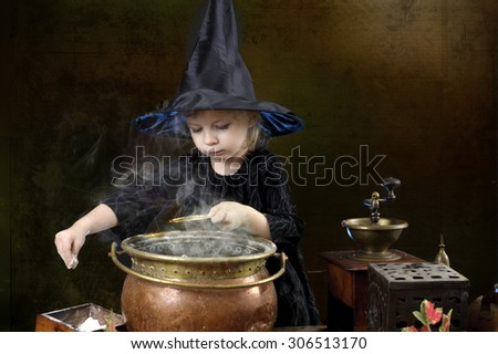 little halloween witch with cauldron - stock photo