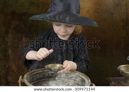 little halloween witch with cauldron in an ancient kitchen