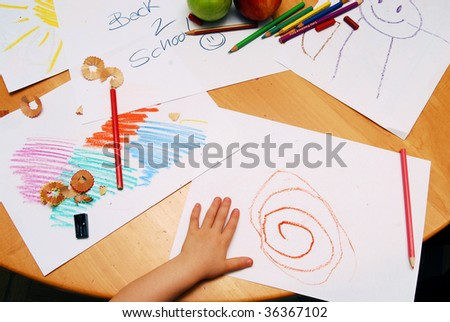 Little hand drawing between school supplies and apples - stock photo
