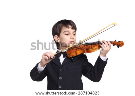 little handsome boy sleeping playing the violin isolated on white