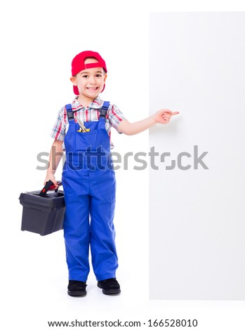 Little handyman with toolbox, pointing at big, empty advertising panel - stock photo