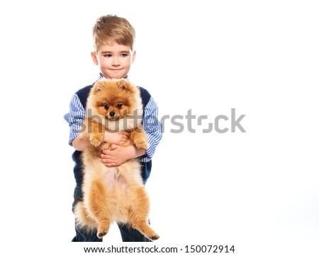 Little happy boy holding spitz - stock photo