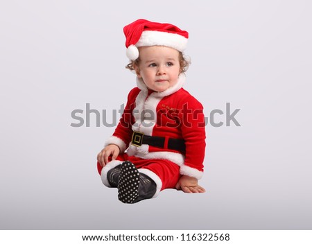 Little happy boy in Santa claus.