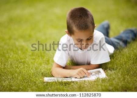 little happy boy reading book