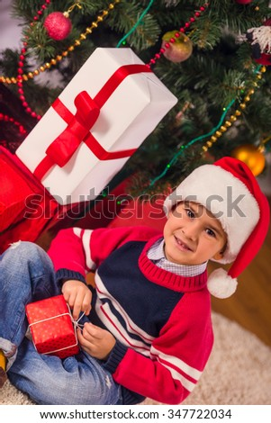 Little happy boy while celebrating Christmas at home - stock photo