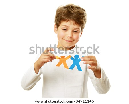 Little happy child holding paper people - united culturally diverse population concept - stock photo