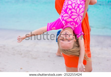 Little happy girl enjoy summer vacation with her mom during white beach - stock photo