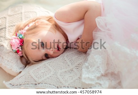 Little happy girl in white dress outdoor - stock photo