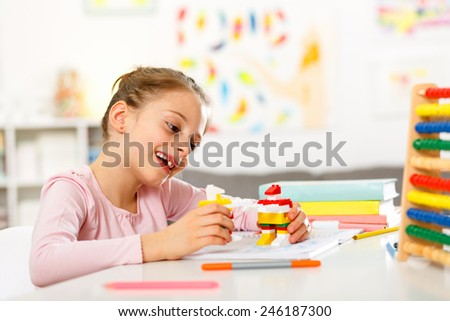 Little happy girl playing in the house - stock photo