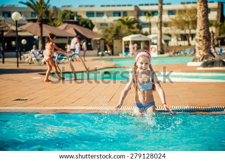 little happy girl swims in the pool - stock photo