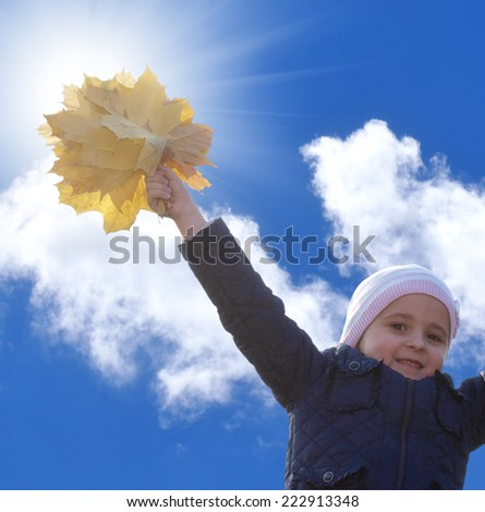 Little happy girl with autumn yellow leaves.Season Autumn - stock photo