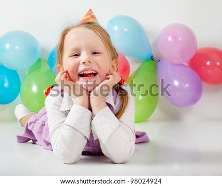 Little happy girl with balloons - stock photo
