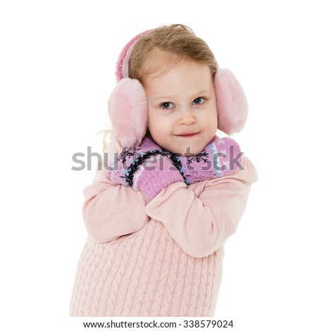 Little happy pretty girl in winter clothes stands on a white background. 3 year old. - stock photo