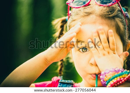 Little happy pretty girl outdoor in the park - stock photo