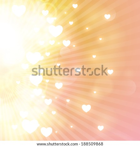Little hearts floating on rays of light.  - stock photo