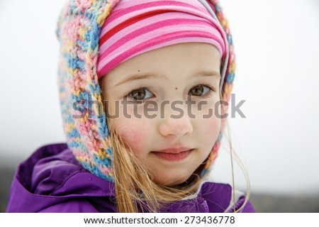 Little hiker girl with knitted hoodie, thoughtfully gazing at her dad on a trip to Mt. Etna, Sicily, Italy. Active family lifestyle, traveling family concept.  - stock photo