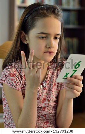 Little Hispanic Girl doing Math Cards - stock photo