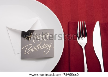 Little holiday cards on the table with the objects table set. - stock photo