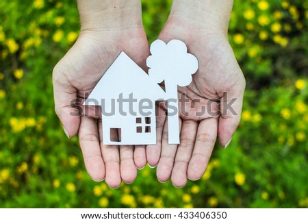 Little home paper in kid hands. - stock photo