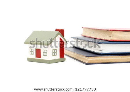 little house and books isolated on white background