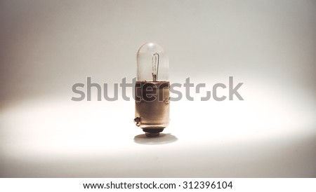 Little Incandescent lamp used to illuminate the vehicle interior with a thin spiral
