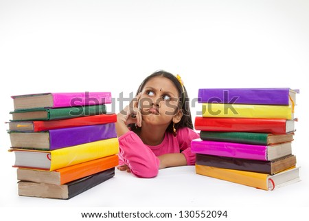 little indian girl thinking or dreaming during preparing homework - stock photo