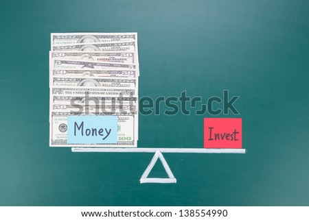 Little investments for much money, balance concept drawing on blackboard - stock photo