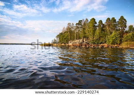 little island and  calm waves in Baltic sea, Vyborg bay