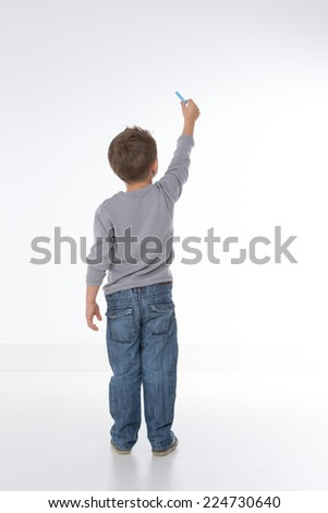 little kid about to draw something - stock photo