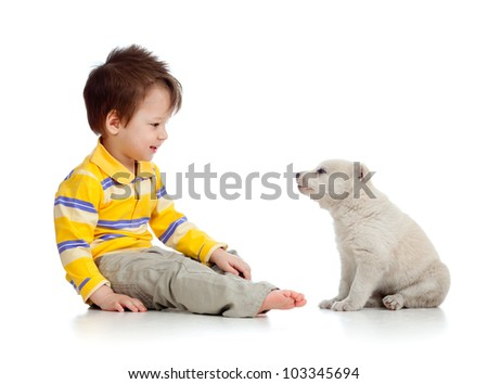 little kid and puppy looking at each other on white background - stock photo