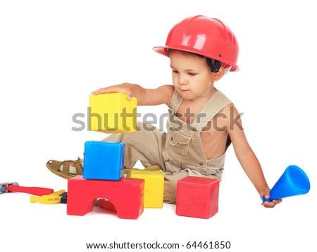 Little kid as a construction worker in red protective helmet on white background - stock photo