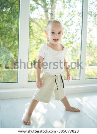 Little kid at home - stock photo