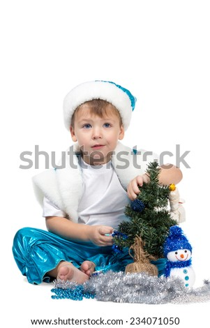 Little kid boy in New Year costumes decorated Christmas tree and looking at the camera isolated on a white background - stock photo