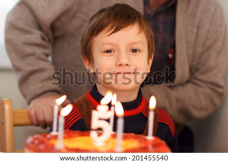 Little kid celebrate birthday with grandpa at home - stock photo
